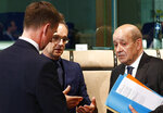 French Foreign Minister Jean-Yves Le Drian, right, speaks with German counterpart Heiko Maas, center, and British Foreign Secretary Jeremy Hunt during a meeting at the European Council in Brussels, Monday, May 13, 2019. (Francois Lenoir, Pool Photo via AP)