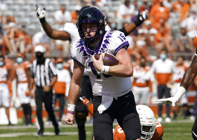 TCU quarterback Max Duggan (15) scores a touchdown on a run against Texas during the first half of an NCAA college football game, Saturday, Oct. 3, 2020, in Austin, Texas. (AP Photo/Eric Gay)