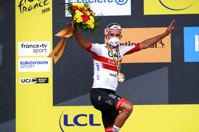 Alexander Kristoff of Norway celebrates on the podium after winning the first stage of the Tour de France cycling race over 156 kilometers (97 miles) with start and finish in Nice, southern France, Saturday, Aug. 29, 2020. (Christophe Petit-Tesson/Pool via AP)