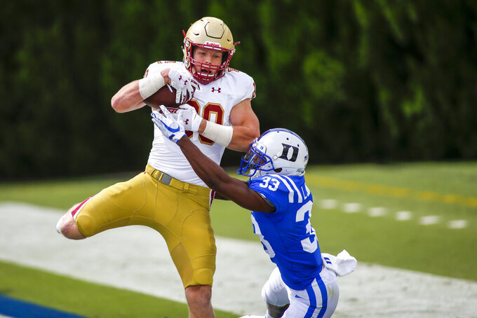 Boston College tight end Hunter Long (80) catches a touchdown pass against Duke Blue cornerback Leonard Johnson (33) during the second half of an NCAA college football game, Saturday, Sept. 19, 2020, in Durham, N.C. (Nell Redmond/Pool Photo via AP)