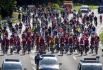Demonstrators ride their bikes on a highway in Frankfurt, Germany, Saturday, Sept. 14, 2019. About 20 000 cyclists took part in a protest star ride against the government's transport policy on occasion of this year's IAA Auto Show.(AP Photo/Michael Probst)
