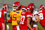 Kansas City Chiefs quarterback Patrick Mahomes (15) and tight end Travis Kelce (87) pass each other while running during an NFL football training camp Saturday, Aug. 15, 2020, in Kansas City, Mo. (AP Photo/Charlie Riedel)