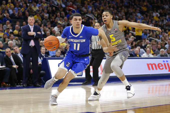 Creighton's Marcus Zegarowski (11) drives to the basket against Marquette's Greg Elliott (5) during the second half of an NCAA college basketball game Tuesday, Feb. 18, 2020, in Milwaukee. (AP Photo/Aaron Gash)