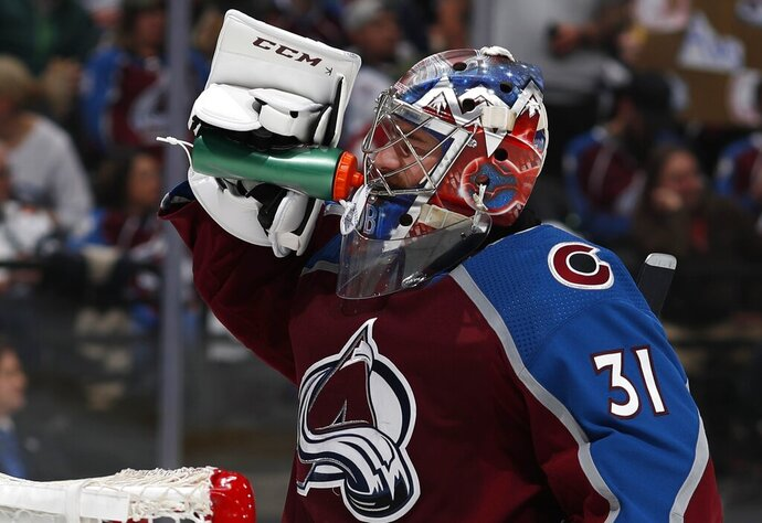 Colorado Avalanche goaltender Philipp Grubauer takes a drink during the second period of Game 4 of the team's NHL hockey second-round playoff series against the San Jose Sharks on Thursday, May 2, 2019, in Denver. (AP Photo/David Zalubowski)