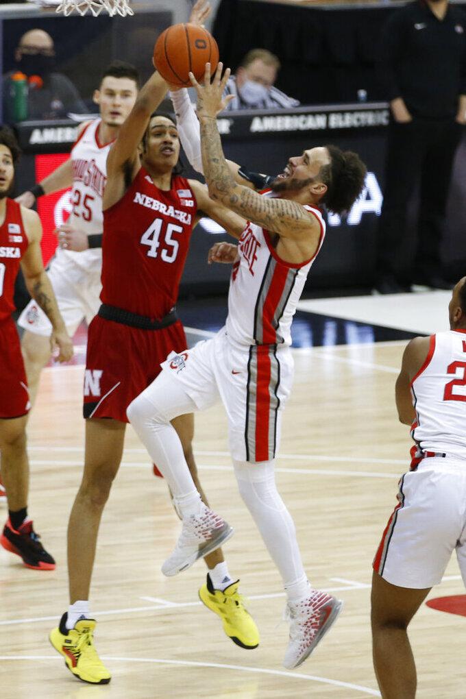 Ohio State's Duane Washington, right, shoots next to Nebraska's Dalano Banton during the second half of an NCAA college basketball game Wednesday, Dec. 30, 2020, in Columbus, Ohio. (AP Photo/Jay LaPrete)