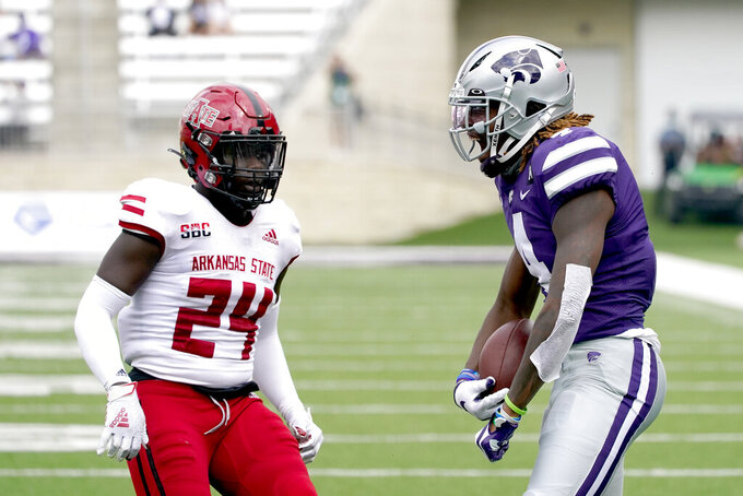 Kansas State wide receiver Malik Knowles, right, celebrates after catching a pass during the first half of an NCAA college football game against Arkansas State Saturday, Sept. 12, 2020, in Manhattan, Kan. (AP Photo/Charlie Riedel)