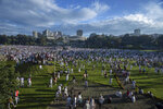 Ethiopians participate in the annual Irrecha thanksgiving festival in the capital Addis Ababa, Ethiopia Saturday, Oct. 5, 2019. The annual Irrecha festival of Ethiopia's largest ethnic group, the Oromo, attracted millions from across Ethiopia and was held in the capital for the first time after 150 years on Saturday. (AP Photo/Mulugeta Ayene)