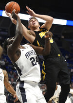 Iowa guard Jordan Bohannon (3) takes a shot over Penn State forward Mike Watkins (24) during the first half of an NCAA college basketball game Wednesday, Jan. 16, 2019, in State College, Pa. (AP Photo/John Beale)