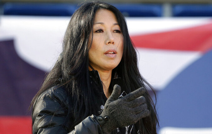 FILE - In this Dec. 23, 2018, file photo, Buffalo Sabres co-owner/president Kim Pegula stands on the field before an NFL football game between the Buffalo Bills and New England Patriots in Foxborough, Mass. Pegula is staying on as Sabres president with a continued focus on making the small-market franchise economically sustainable, while in the face of criticism the team has been mismanaged under her leadership. The team's co-owner told The Associated Press in a recent interview she believes she remains the best-suited for the job to streamline the operation, while acknowledging the process has taken longer than expected. (AP Photo/Steven Senne, File)