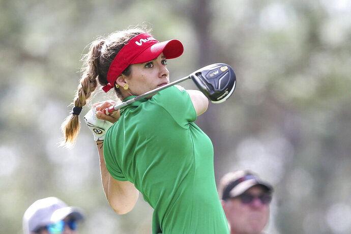 Gaby Lopez, of Mexico, drives from the 2nd tee during during the final round of the Tournament of Champions LPGA golf tournament Sunday, Jan. 19, 2020, in Lake Buena Vista, Fla. (AP Photo/Gary McCullough)