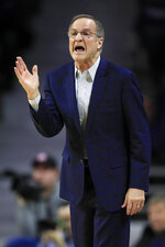 Oklahoma head coach Lon Kruger directs his team during the first half of an NCAA college basketball game against Kansas State in Manhattan, Kan., Wednesday, Jan. 29, 2020. (AP Photo/Orlin Wagner)