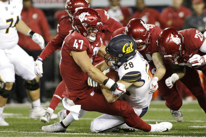 Washington State linebacker Peyton Pelluer (47) tackles California running back Patrick Laird (28) during the first half of an NCAA college football game in Pullman, Wash., Saturday, Nov. 3, 2018. (AP Photo/Young Kwak)