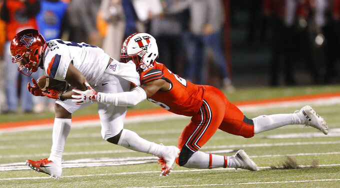 Arizona wide receiver Shun Brown, left, catches a pass against Utah defensive back Javelin K. Guidry during the first half of an NCAA college football game Friday, Oct. 12, 2018, in Salt Lake City. (AP Photo/Rick Bowmer)