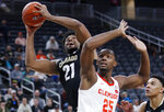 Colorado's Evan Battey (21) shoots around Clemson's Aamir Simms (25) during the second half of an NCAA college basketball game, Tuesday, Nov. 26, 2019, in Las Vegas. (AP Photo/John Locher)
