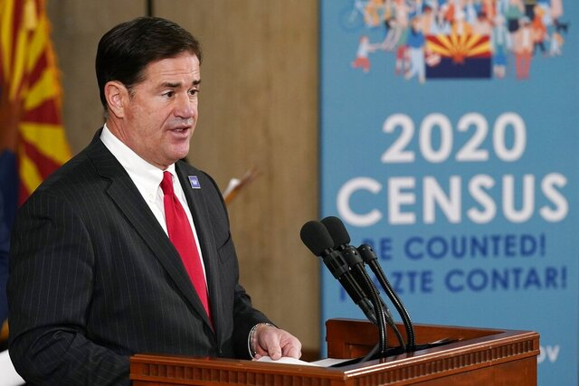 Arizona Gov. Doug Ducey speaks at a news conference with U.S. Census Director Steven Dillingham and other state leaders to urge Arizonans to participate in the nation's once-a-decade census population count Thursday, Sept. 17, 2020, in Phoenix. Ending the 2020 census at the end of September instead of the end of October, could cost Florida and Montana congressional seats and result in Texas, Florida, Arizona, Georgia, and North Carolina losing $500 million in federal funding for healthcare for its neediest residents. (AP Photo/Ross D. Franklin, Pool)