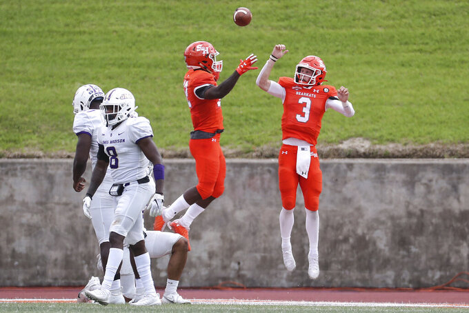 Sam Houston State quarterback Eric Schmid (3) and wide receiver Jequez Ezzard (12) celebrate Schid's touchdown against James Madison during the third quarter of a semifinal game in the NCAA college football FCS playoffs, Saturday, May 8, 2021, in Huntsville, Texas. Sam Houston came from behind to edge James Madison 38-35, for a berth in the FCS national championship game. (Brett Coomer/Houston Chronicle via AP)