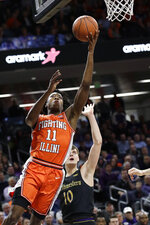 Illinois guard Ayo Dosunmu, left, drives to the basket past Northwestern forward Miller Kopp during the first half of an NCAA college basketball game in Evanston, Ill., Thursday, Feb. 27, 2020. (AP Photo/Nam Y. Huh)