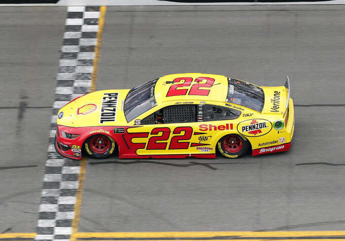 Joey Logano crosses the finish line to win the first stage of a NASCAR Cup Series auto race at Daytona International Speedway, Sunday, July 7, 2019, in Daytona Beach, Fla. (AP Photo/John Raoux)
