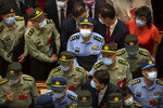 Military delegates wait to leave after the closing session of China's National People's Congress (NPC) at the Great Hall of the People in Beijing, Thursday, May 28, 2020. China's ceremonial legislature has endorsed a national security law for Hong Kong that has strained relations with the United States and Britain. (AP Photo/Mark Schiefelbein)