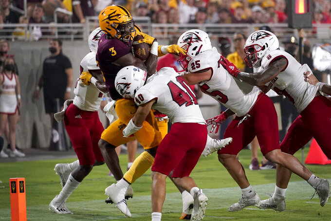 Arizona State running back Rachaad White (3) is stopped at the goal line by Southern Utah linebacker Jayden Clark (25) and safety Treyson Johnson (40) during the first half of an NCAA college football game, Thursday, Sept. 2, 2021, in Tempe, Ariz. (AP Photo/Matt York)