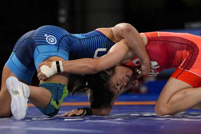 Japan's Risako Kawai, right, and United States Helen Louise Maroulis compete during the women's 57kg Freestyle semifinal wrestling match at the 2020 Summer Olympics, Wednesday, Aug. 4, 2021, in Chiba, Japan. (AP Photo/Aaron Favila)