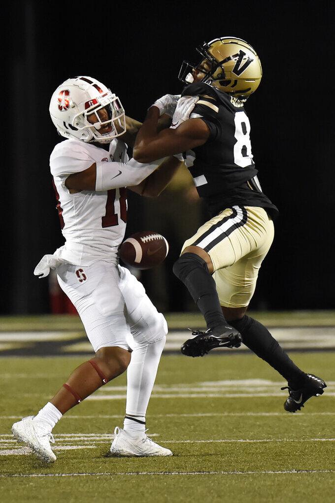 Stanford cornerback Jimmy Wyrick, left, breaks up a pass intended for Vanderbilt wide receiver Devin Boddie Jr. (82) in the first half of an NCAA college football game Saturday, Sept. 18, 2021, in Nashville, Tenn. (AP Photo/Mark Zaleski)