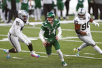 New York Jets quarterback Sam Darnold, center, scrambles during a two-point conversion attempt during the second half an NFL football game against the Las Vegas Raiders, Sunday, Dec. 6, 2020, in East Rutherford, N.J. (AP Photo/Noah K. Murray)