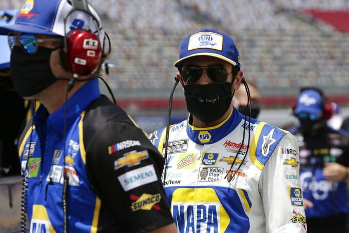 Driver Chase Elliott walks along pit road during qualifying prior to a NASCAR Cup Series auto race at Charlotte Motor Speedway Sunday, May 24, 2020, in Concord, N.C. (AP Photo/Gerry Broome)