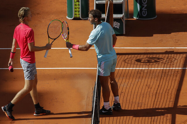 Sebastian Korda of the U.S. congratulates Spain's Rafael Nadal, right, with his win in the fourth round match of the French Open tennis tournament at the Roland Garros stadium in Paris, France, Sunday, Oct. 4, 2020. (AP Photo/Alessandra Tarantino)