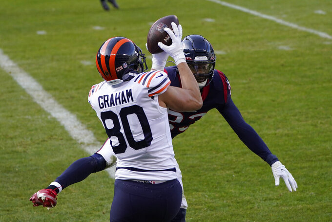 Chicago Bears' Jimmy Graham (80) makes a touchdown catch against Houston Texans' Eric Murray (23) during the first half of an NFL football game, Sunday, Dec. 13, 2020, in Chicago. (AP Photo/Charles Rex Arbogast)