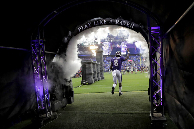 Baltimore Ravens quarterback Lamar Jackson is introduced for the team's NFL football preseason game against the Jacksonville Jaguars, Thursday, Aug. 8, 2019, in Baltimore. (AP Photo/Julio Cortez