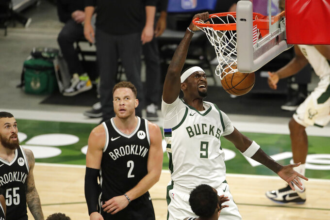 Milwaukee Bucks' Bobby Portis dunks during the first half of an NBA basketball game against the Brooklyn Nets Tuesday, May 4, 2021, in Milwaukee. (AP Photo/Aaron Gash)