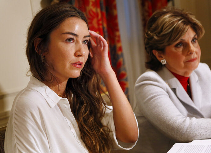 FILE- In this Oct. 24, 2017, file photo, Mimi Haleyi, left, appears at a news conference with her attorney, Gloria Allred, in New York. Haleyi, who testified against Hollywood mogul Harvey Weinstein, has filed a lawsuit against him Friday, Oct. 30, 2020, seeking damages for what she described as lasting injuries. The former