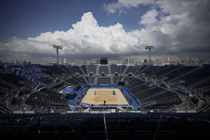The sand is empty during first women's beach volleyball match of the 2020 Summer Olympics between Japan and Czech Republic after it was canceled, Saturday, July 24, 2021, in Tokyo, Japan. The Czech team says beach volleyball player Markéta Sluková has entered a quarantine hotel after testing positive for COVID-19. (AP Photo/Felipe Dana)