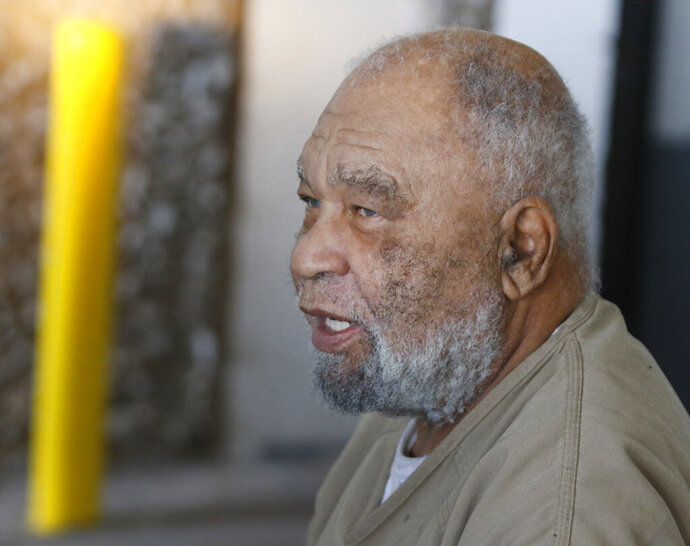 CORRECTS AGE TO 79 - FILE - In this Nov. 26, 2018 file photo, Samuel Little, who often went by the name Samuel McDowell, leaves the Ector County Courthouse after attending a pre-trial hearing in Odessa, Texas.  Little is scheduled Friday, Aug. 23, 2019 to appear via Skype from California state prison, where he is serving multiple life sentences. Court documents show Hamilton County Judge Melba Marsh will sentence the 79-year-old man after his pleas. Little is charged with the 1981 murder of 32-year-old Anna Stewart, last seen alive in Cincinnati. (Mark Rogers/Odessa American via AP, File)