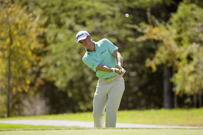 Justin Thomas chips the ball onto the third green of the Silverado Resort North Course during the pro-am event of the Safeway Open PGA golf tournament Wednesday, Sept. 25, 2019, in Napa, Calif. (AP Photo/Eric Risberg)