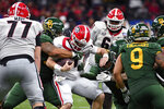 Georgia quarterback Jake Fromm (11) is sacked by Baylor defensive tackle Bravvion Roy in the second half of the Sugar Bowl NCAA college football game in New Orleans, Wednesday, Jan. 1, 2020. (AP Photo/Bill Feig)