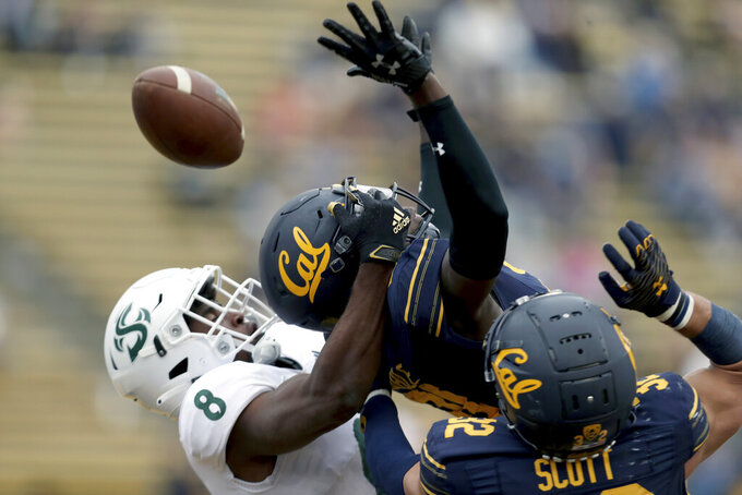 California cornerback Collin Gamble, center, and cornerback Daniel Scott (32) break up a pass against Sacramento State wide receiver Jared Gipson (8) during the second half of an NCAA college football game on Saturday, Sept. 18, 2021, in Berkeley, Calif. (AP Photo/Jed Jacobsohn)