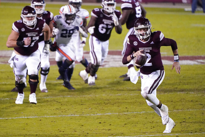 Mississippi State quarterback Will Rogers (2) scrambles for a first down against Auburn during the second half of an NCAA college football game, Saturday, Dec. 12, 2020, in Starkville, Miss. (AP Photo/Rogelio V. Solis)