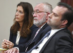 FILE - In this June 11, 2019 file photo, William Strampel, center, the ex-dean of MSU's College of Osteopathic Medicine and former boss of Larry Nassar, appears during closing arguments in his trial before Judge Joyce Draganchuk at Veterans Memorial Courthouse in Lansing, Mich. Strampel was found guilty Wednesday of neglect of duty and misconduct in office but acquitted on a more serious criminal sexual conduct charge. (J. Scott Park/Jackson Citizen Patriot via AP File)