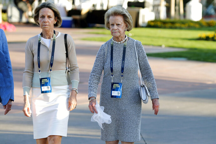 FILE - In this March 24, 2019, file photo, Detroit Lions owner and chairwoman Martha Firestone Ford, right, along with daughter Sheila Hamp, arrives at the annual NFL owners meetings in Phoenix. Martha Firestone Ford is stepping down as principal owner of the Detroit Lions. The Lions announced Tuesday, June 23, 2020, that Ford's daughter, Sheila Ford Hamp, is taking over as the team's principal owner and chairman. (AP Photo/Ralph Freso, File)