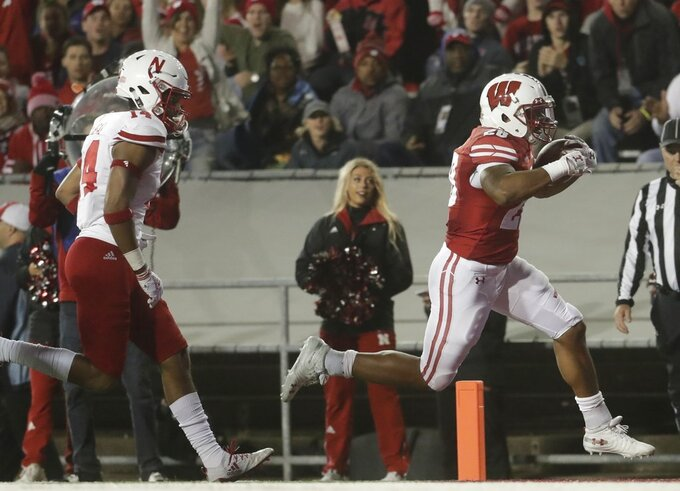 Wisconsin's Taiwan Deal runs for a touchdown during the second half of an NCAA college football game against Nebraska Saturday, Oct. 6, 2018, in Madison, Wis. (AP Photo/Morry Gash)