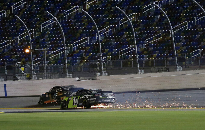Ross Chastain (10) and Michael Annett (1) try to drive back to pit road after crashing on the last lap of a NASCAR Xfinity auto race at Daytona International Speedway, Friday, Aug. 28, 2020, in Daytona Beach, Fla. (AP Photo/Terry Renna)