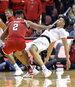Louisville forward Jordan Nwora (33) takes a charge from North Carolina State guard Torin Dorn (2) during the second half of an NCAA college basketball game in Louisville, Ky., Thursday, Jan. 24, 2019. Louisville won 84-77. (AP Photo/Timothy D. Easley)