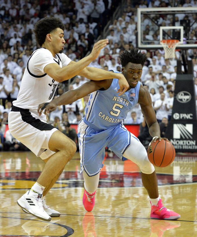 North Carolina forward Nassir Little (5) drives around the defense of Louisville forward Jordan Nwora (33) during the first half of an NCAA college basketball game in Louisville, Ky., Saturday, Feb. 2, 2019. (AP Photo/Timothy D. Easley)