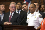 In this Thursday, Aug. 15, 2019 photo, Philadelphia Police Commissioner Richard Ross, right, speaks during a news conference as Mayor Jim Kenney looks on at City Hall in Philadelphia. The mayor of Philadelphia says on Tuesday, Aug. 20, 2019, that Ross is resigning over new allegations of sexual harassment and racial and gender discrimination against others in the department. Kenney says that Richard Ross has been a terrific asset to the police department and the city as a whole and that he's disappointed to lose him. (AP Photo/Matt Rourke)
