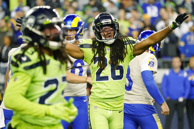 Seattle Seahawks defensive back Ryan Neal (26) reacts to a play against the Los Angeles Rams during the second half of an NFL football game, Thursday, Oct. 7, 2021, in Seattle. (AP Photo/Elaine Thompson)