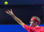 Switzerland's Roger Federer serves to Germany's Peter Gojowczyk at the Swiss Indoor tennis tournament at the St. Jakobshalle in Basel, Switzerland, on Monday, Oct. 21, 2019. Federer went on to win the match. (Georgios Kefalas/Keystone via AP)