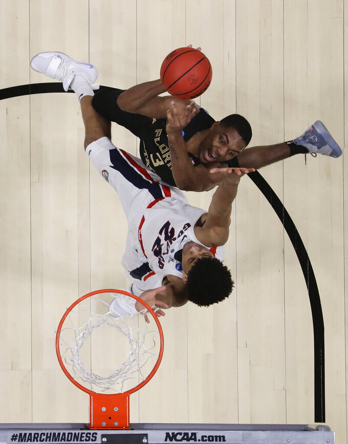 Florida State guard Trent Forrest, top, shoots over Gonzaga guard Zach Norvell Jr. during the second half an NCAA men's college basketball tournament West Region semifinal Thursday, March 28, 2019, in Anaheim, Calif. (AP Photo/Marcio Jose Sanchez)
