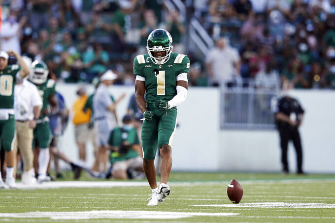 Charlotte wide receiver Victor Tucker (1) reacts after making a play during an NCAA college football game against Duke, Friday, Sept. 3, 2021, in Charlotte, N.C. (AP Photo/Brian Westerholt)